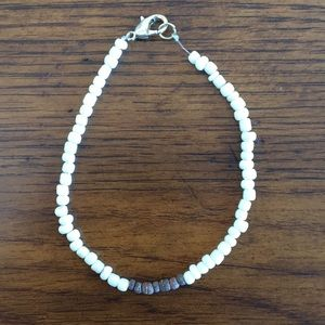 White and brown beachy anklet.